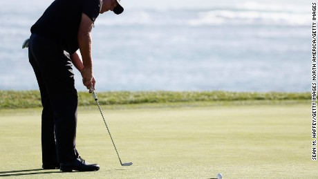 Mickelson watches on as his crucial putt rolls past the hole.