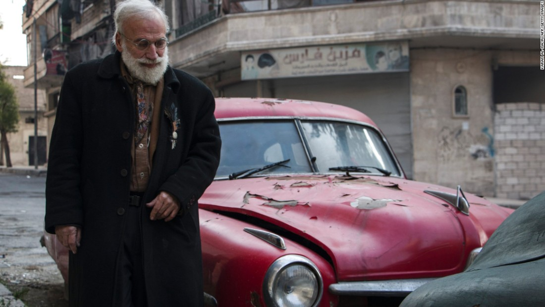 The 69-year-old's family fled fighting in Aleppo, but he stayed behind to care for his cars.