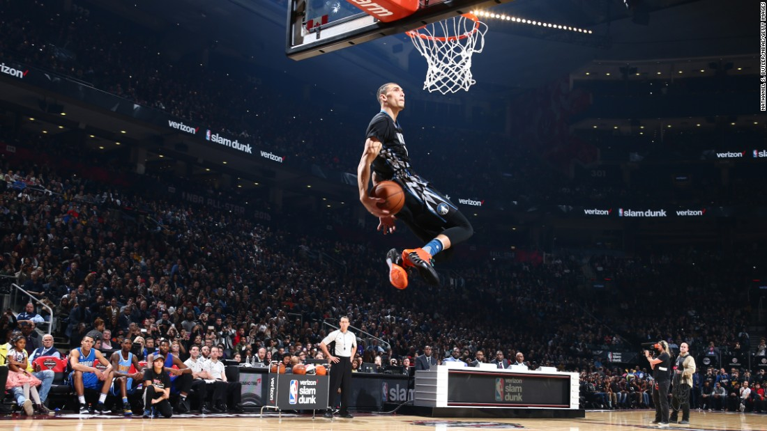 "Zach LaVine goes behind the back on his way to winning the NBA Slam Dunk Contest on Saturday, February 13. LaVine and Aaron Gordon traded perfect 50s throughout the final round, but in the end it was LaVine winning for the second straight year. <a href=""http://www.cnn.com/2016/02/08/sport/gallery/nba-all-star-slam-dunk-champs/index.html"" target=""_blank"">See all the dunk contest champions since 1984</a>"