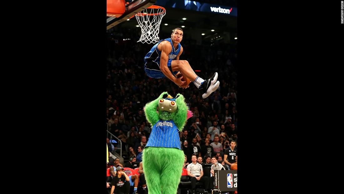 Orlando's Aaron Gordon leaps over the team's mascot, Stuff the Magic Dragon, during the NBA Slam Dunk Contest on Saturday, February 13. Gordon scored a perfect 50 on the dunk, one of three 50s he had in the final round. But Zach LaVine had four.