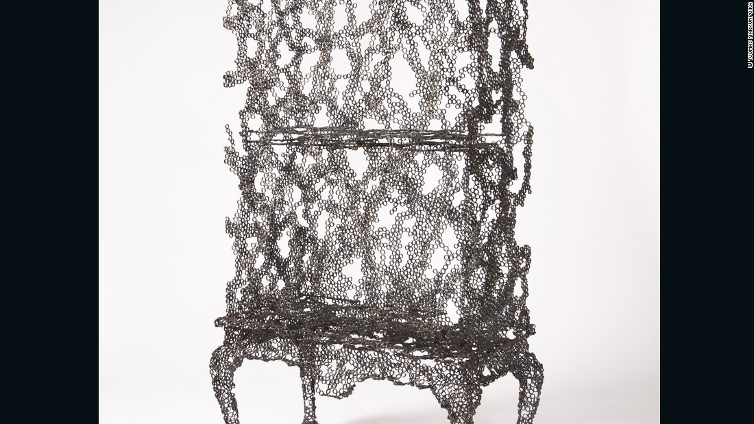 This piece is inspired by the designer's grandmother. A frame of a cabinet is created using small rings of steel -- a work about his grandmother's failing memory.