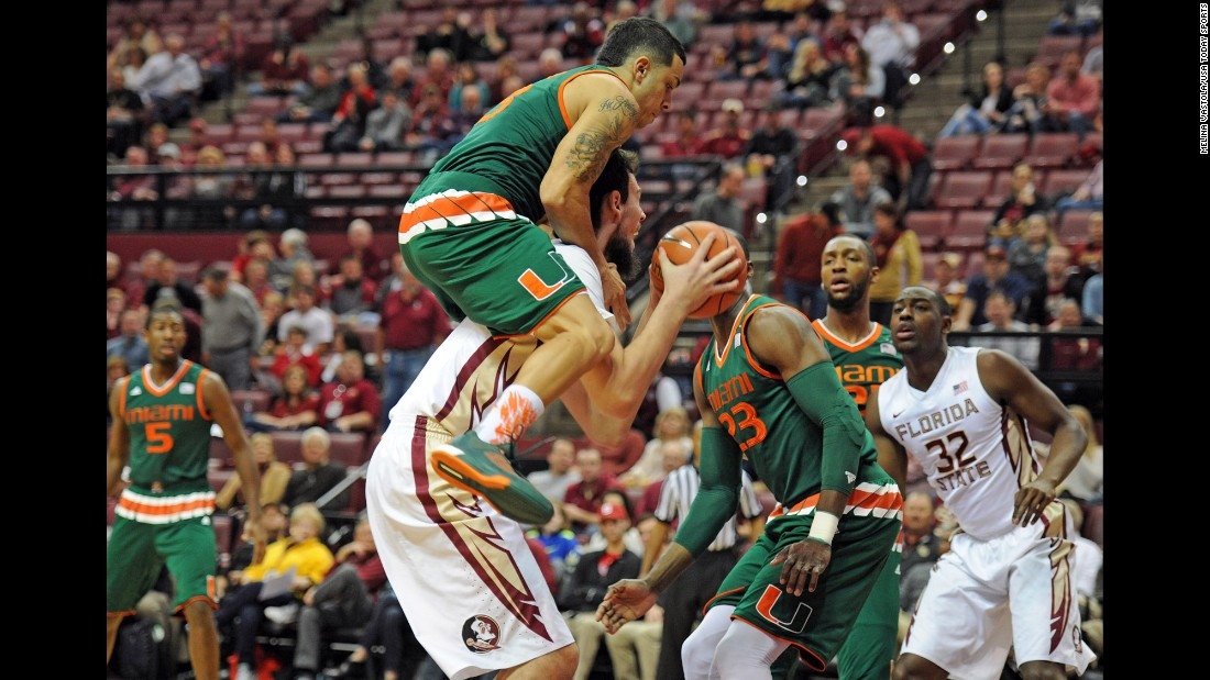 Miami guard Angel Rodriguez fouls Florida State center Boris Bojanovsky during an ACC game in Tallahassee, Florida, on Sunday, February 14.