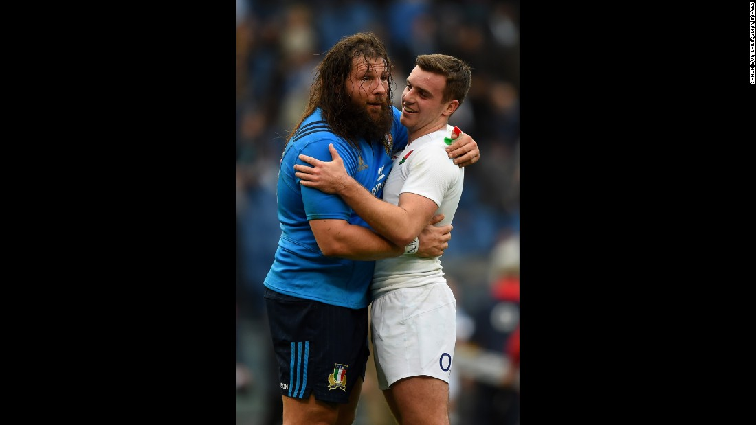 Italian rugby player Martin Castrogiovanni, left, hugs England's George Ford after a Six Nations match in Rome on Sunday, February 14. England won the match 40-9.