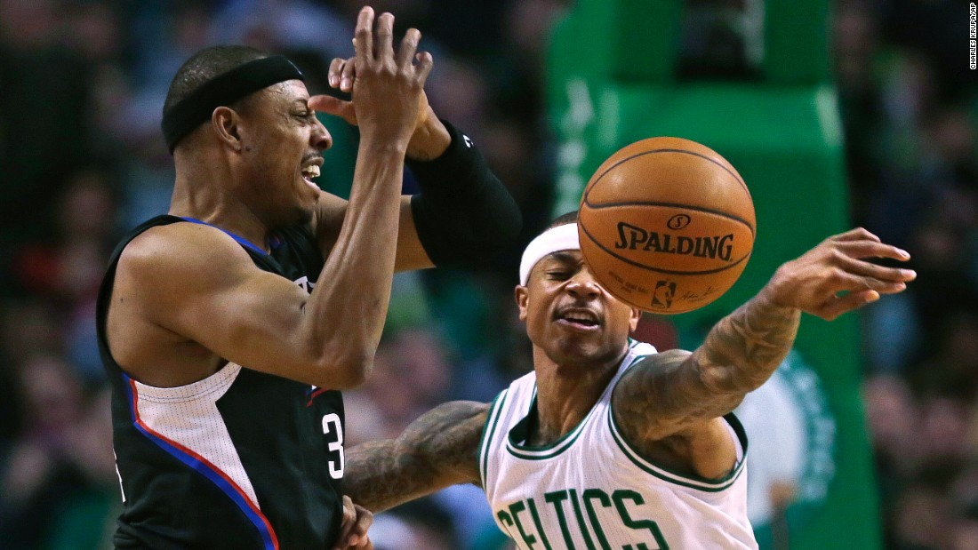 Boston guard Isaiah Thomas knocks away a pass from Paul Pierce during an NBA game in Boston on Wednesday, February 10.