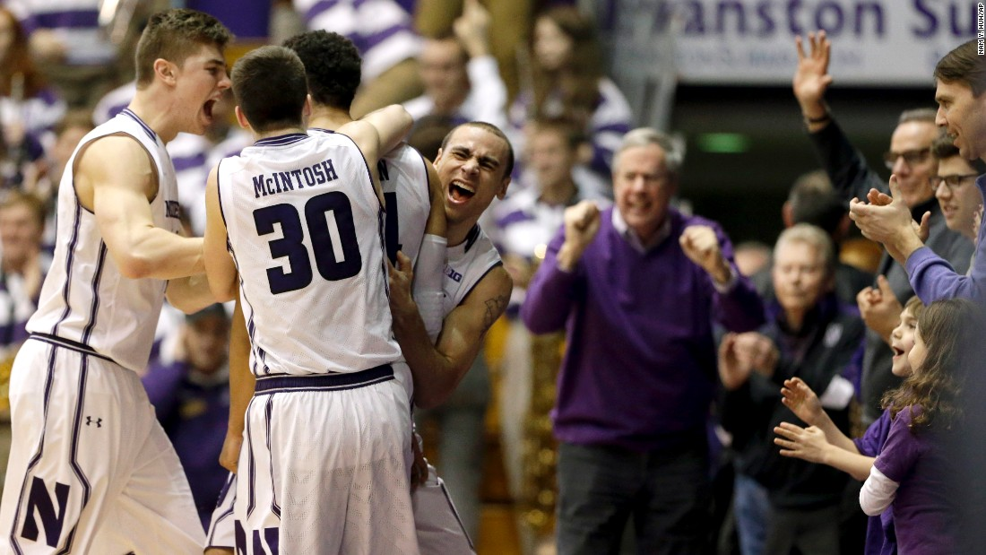 Northwestern basketball players celebrate after they defeated in-state rivals Illinois on Saturday, February 13