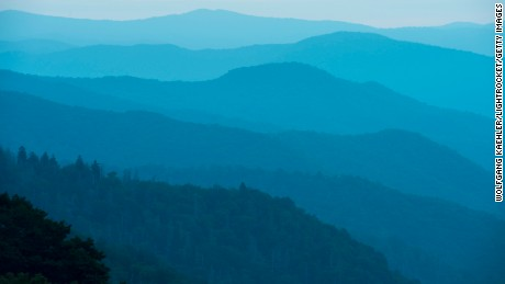 UNITED STATES - 2015/09/20: View from the Oconaluftee Overlook of the Oconaluftee Valley with hazy mountain ridges at sunrise in the Great Smoky Mountains National Park in North Carolina, USA. (Photo by Wolfgang Kaehler/LightRocket via Getty Images)