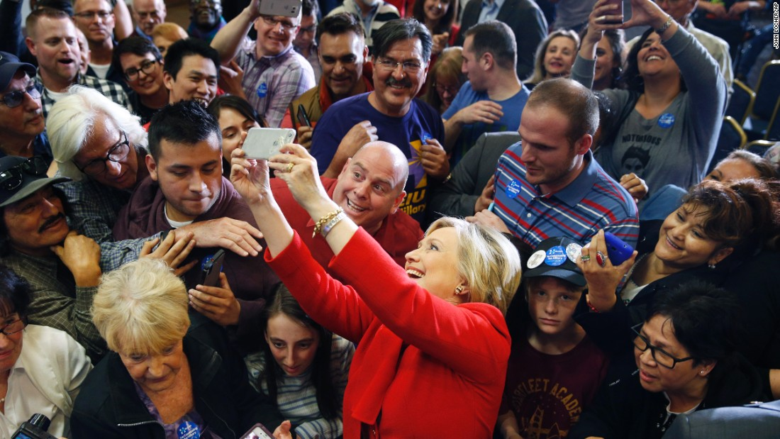 Democratic presidential candidate Hillary Clinton takes a selfie with supporters during a rally in Las Vegas on Sunday, February 14.