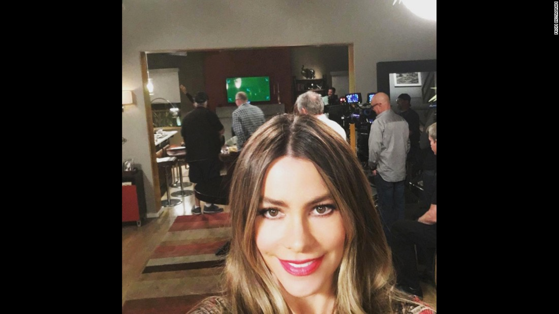 "Actress Sofia Vergara <a href=""https://www.instagram.com/p/BBtDuNXrpau/"" target=""_blank"">snaps a photo</a> on the set of ""Modern Family"" on Friday, February 12."