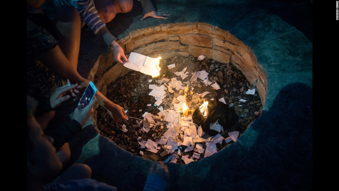 Klein attended a residential treatment center for two months. At the end of an alumnae retreat, they burn pieces of paper where they had written down things they want to let go of.