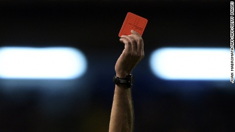 A referee shows a red card during a Copa Sudamericana match in Argentina in 2014.