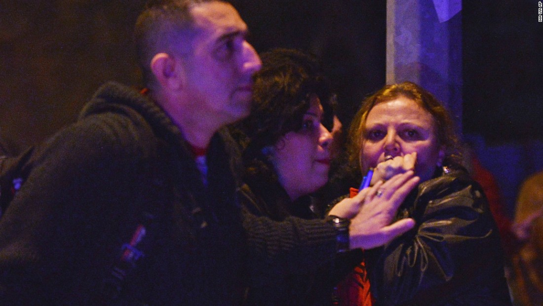 People react at the scene of the explosion.