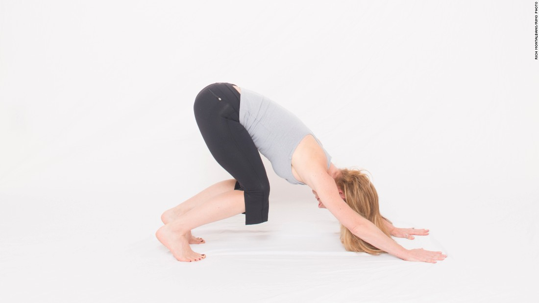Keep your knees bent in downward dog as you work on alignment, strength and mobility before attempting the full expression of the pose with straight legs and full shoulder flexion. You can also slowly pedal out your heels, by straightening one leg at a time to ease into the posture.