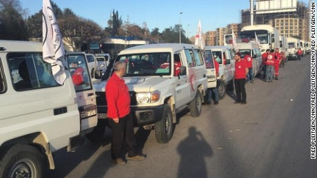 U.N. vehicles get ready to head to Madaya, Syria.