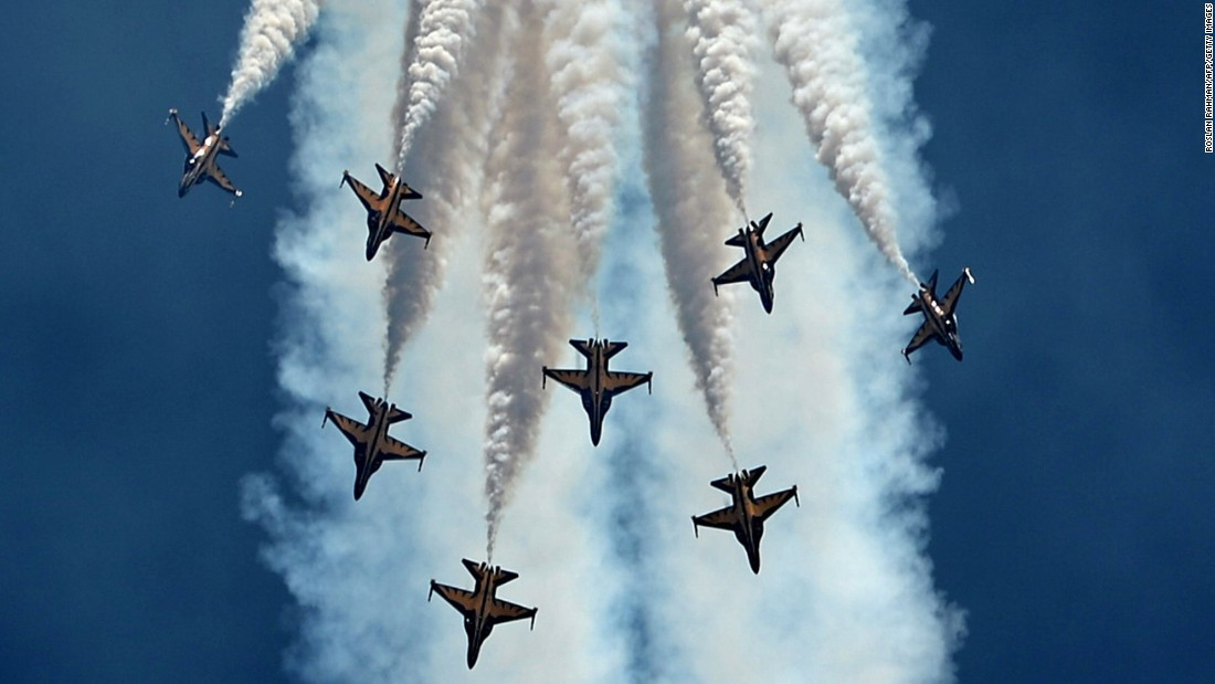 South Korea's Black Eagles aerobatics team flying KAI T-50B aircraft performs an aerial display during the Singapore Airshow on February 16.