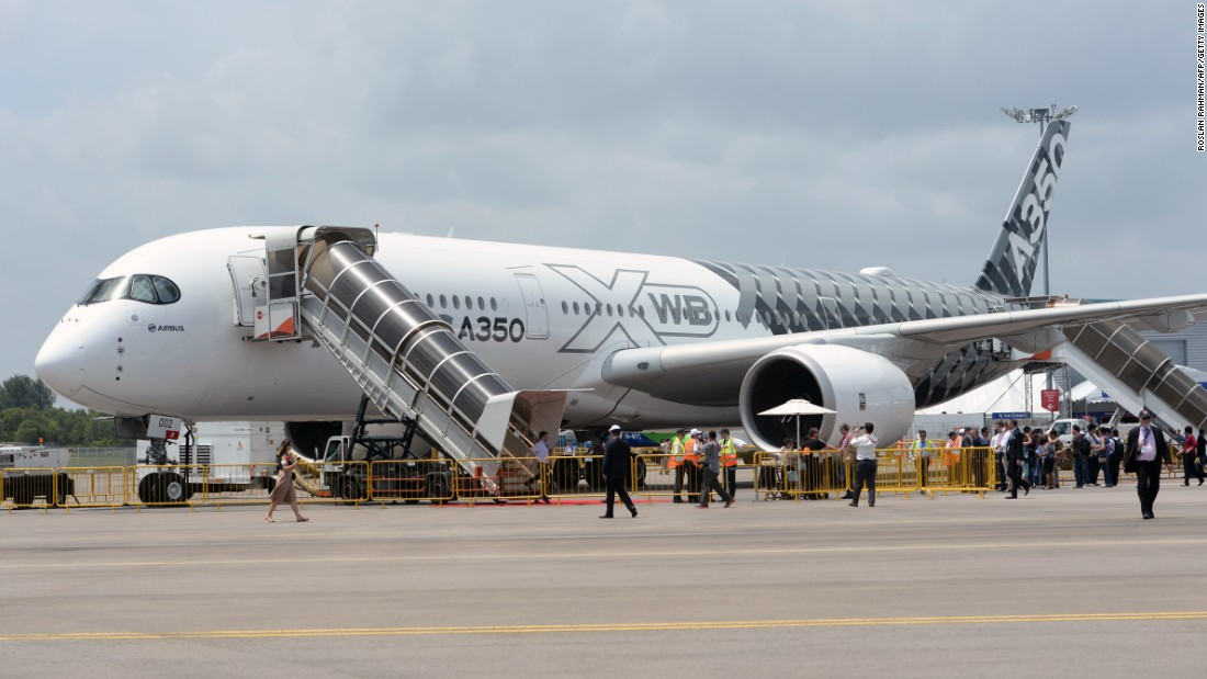 "Airbus A350 XWB aircraft on static display during the Singapore Airshow on February 17. Airbus says the new A350 XWB is the ""world's most technologically advanced commercial aircraft family."""