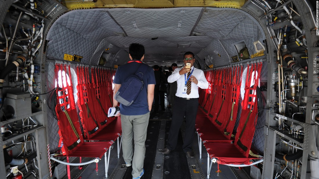 Visitors look at interior of a Boeing CH-47 Chinook helicopter on display by the Singapore Air Force during the Singapore Airshow on February 17.