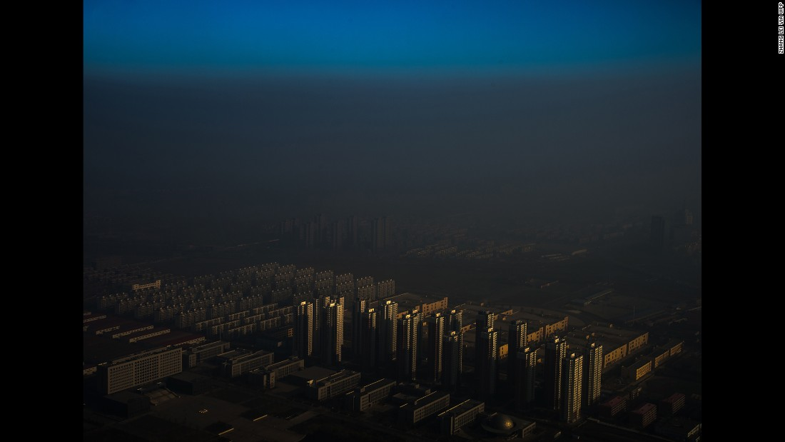 Tianjin, a city in northern China, is shrouded in haze on December 10.