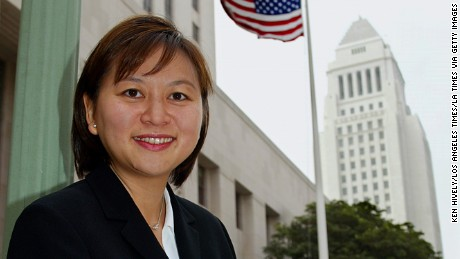 JACQUELINE NGUYEN is the first Vietnamese American woman named to the state court in California. Photo of Nguyen outside court with Los Angeles city hall in background, August 15, 2002