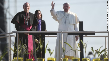 Pope Francis stands on a platform in Mexico as he blesses a group of migrants over on the US side of the border as he prays for those who died trying to cross the border at El Paso, Texas on February 17, 2016.