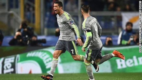 Real Madrid's Portuguese forward Cristiano Ronaldo (L) celebrates with teammate Real Madrid's defender Sergio Ramos after scoring during the UEFA Champions League football match AS Roma vs Real Madrid on Frebruary 17, 2016 at the Olympic stadium in Rome.      AFP PHOTO / FILIPPO MONTEFORTE / AFP / FILIPPO MONTEFORTE        (Photo credit should read FILIPPO MONTEFORTE/AFP/Getty Images)