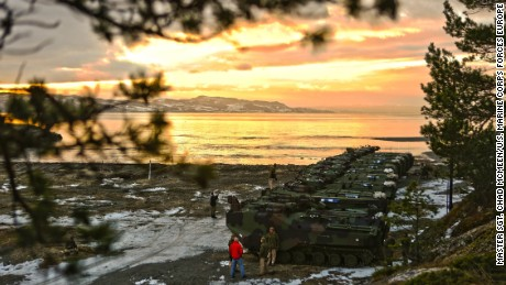 "U.S. Marine Corps amphibious assault vehicles before a public ""splash"" demonstration in the Trondheim Fjord in Norway, Jan. 10. The partnership between the Norwegian military and U.S. Marines enables NATO to pivot toward crisis by alleviating logistics requirements to support a broad-spectrum military operations."