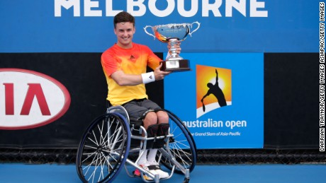 MELBOURNE, AUSTRALIA - JANUARY 30:  Gordon Reid of Great Britain poses with the championship trophy after winning the Men's Wheelchair Singles Final match against Joachim Gerard of Belgium during the Australian Open 2016 Wheelchair Championships at Melbourne Park on January 30, 2016 in Melbourne, Australia.  (Photo by Darrian Traynor/Getty Images)