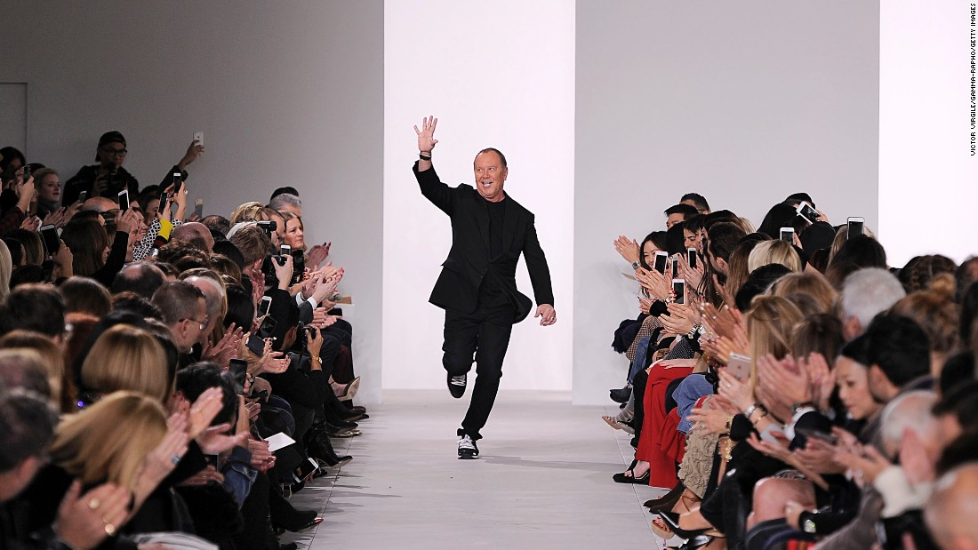 Fashion designer Michael Kors makes an energetic entrance  onto the runway at his line's fall/winter 2016 show. Kors' company, launched in 1981, makes a wide range of men's and women's clothes, accessories, footwear, watches, jewelry, eyewear and fragrances.