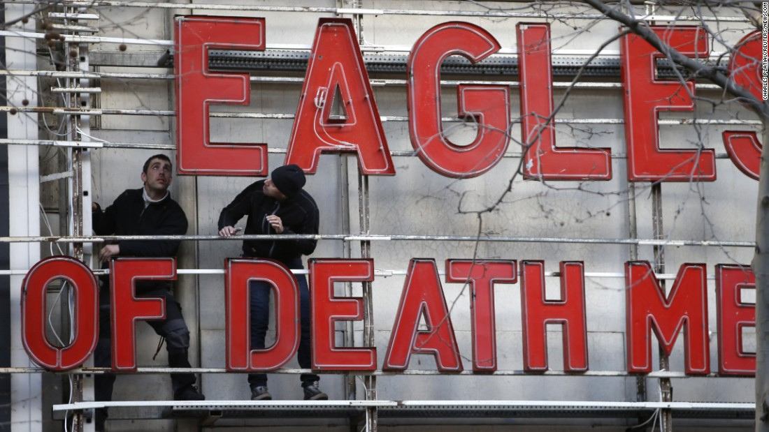 "Workers at the Olympia, a concert hall in Paris, install letters to promote the Eagles of Death Metal on Tuesday, February 16. The band <a href=""http://www.cnn.com/2016/02/16/europe/eagles-of-death-metal-paris-return/"" target=""_blank"">returned to the French capital</a> three months after terrorists attacked their concert, killing 89 people."