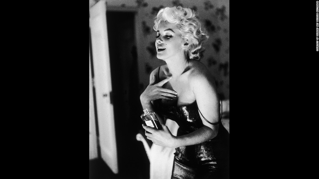"The photographer Ed Feingersh was sent by Redbook magazine to follow Monroe through her daily routine in 1955. She's depicted here holding a bottle of Chanel No. 5. The late actress helped fuel the popularity of the fragrance when she told press: ""What do I wear to bed? Why, Chanel No. 5 of course"""