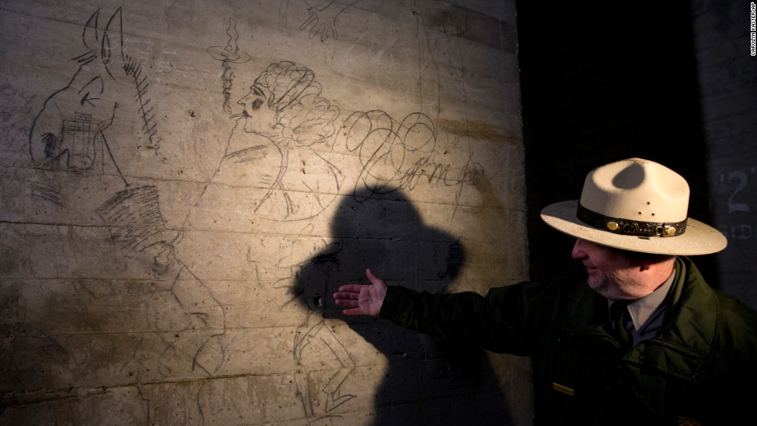 "Sean Kennealy of the National Park Service points out drawings that were made many years ago by construction workers who built the Lincoln Memorial in Washington. The Park Service announced Monday, February 15, that David Rubenstein, a philanthropist who has already donated tens of millions of dollars to refurbish the Washington Monument and other icons,<a href=""http://www.cnn.com/2016/02/16/travel/lincoln-memorial-refurbishment/"" target=""_blank""> is giving $18.5 million</a> to fix up the Lincoln Memorial. The money will go to repairing damaged masonry, cleaning the memorial and conserving murals inside. The money will also pay for a special project that shows visitors some of the graffiti left on the underpinnings of the monument."