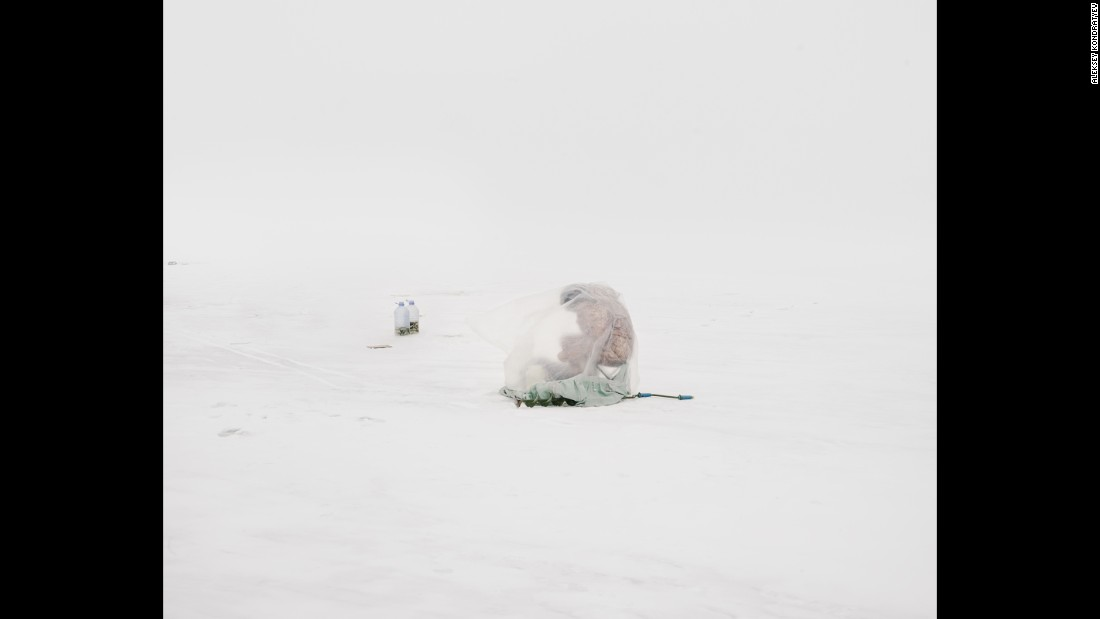 """They're so focused on this practice of ice fishing and they're so cut off from their surroundings,"" Kondratyev said. ""They're isolated by this plastic bag that abstracts their figure."""