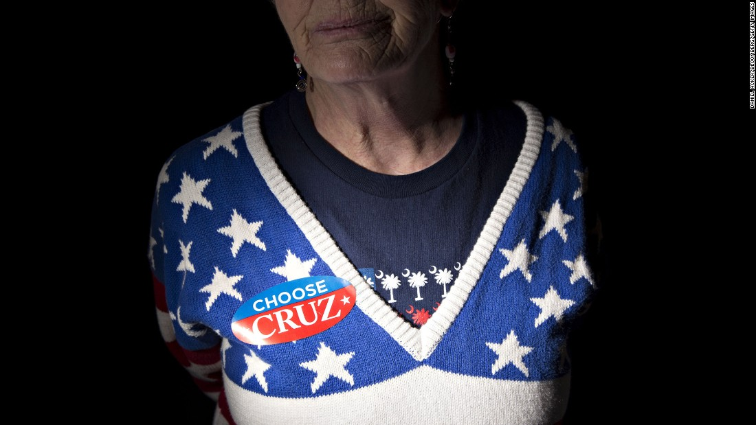 A woman wears a campaign sticker for U.S. Sen. Ted Cruz, a Republican presidential candidate, ahead of a campaign rally in Aiken, South Carolina, on Monday, February 15.