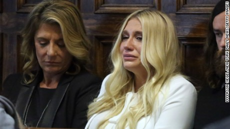 (Pool photo by Jefferson Siegel) - Kesha (center in white) cries as she learns she will not be released from her record label contract in Manhattan Supreme Court on Friday, February 19, 2016. A judge said she would not allow Kesha to leave her record label. (Pool Photo by Jefferson Siegel/NY Daily News via Getty Images)