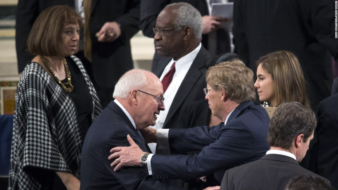Former Vice President Dick Cheney, left, and Supreme Court Justice Clarence Thomas take their seats for the funeral Mass on February 20.