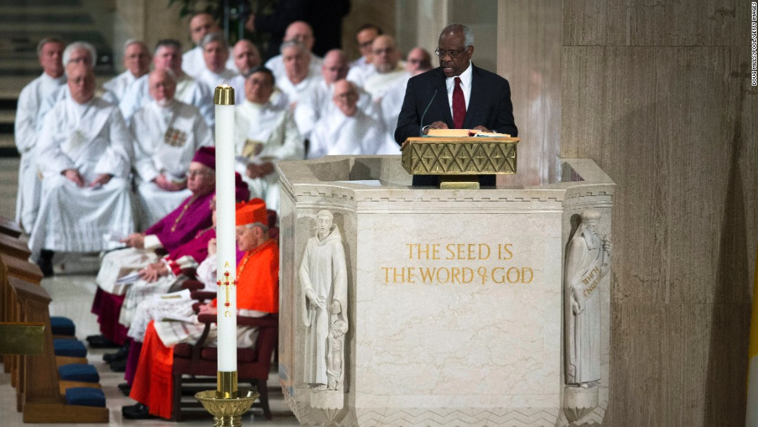 Justice Clarence Thomas delivers a reading during the funeral Mass fo February 20.