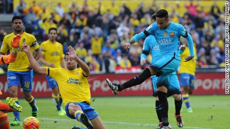 Neymar strikes home Barcelona's second goal in the 2-1 win at Las Palmas in the Estadio Gran Canaria.