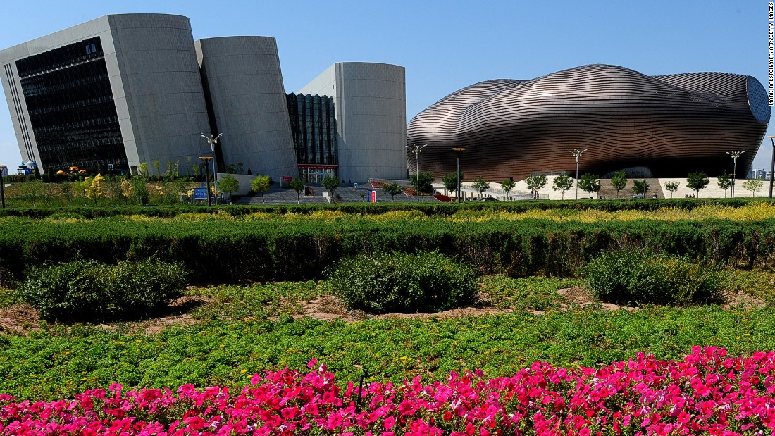 "The city of Ordos is commonly referred to as a ""Ghost Town"" due to its lack of people. Here is a view of the City Library and the Ordos Museum building."