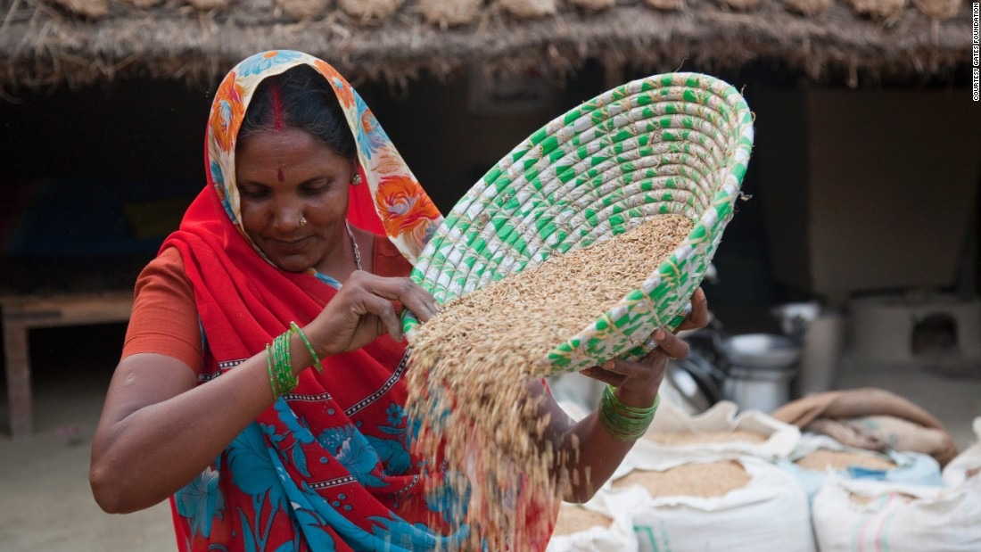 "A farmer winnows rice in the Maharajganj district of India. In poor areas of the world, ""many women's lives consist of six or seven or more hours of unpaid work every day,"" say Bill and Melinda Gates."