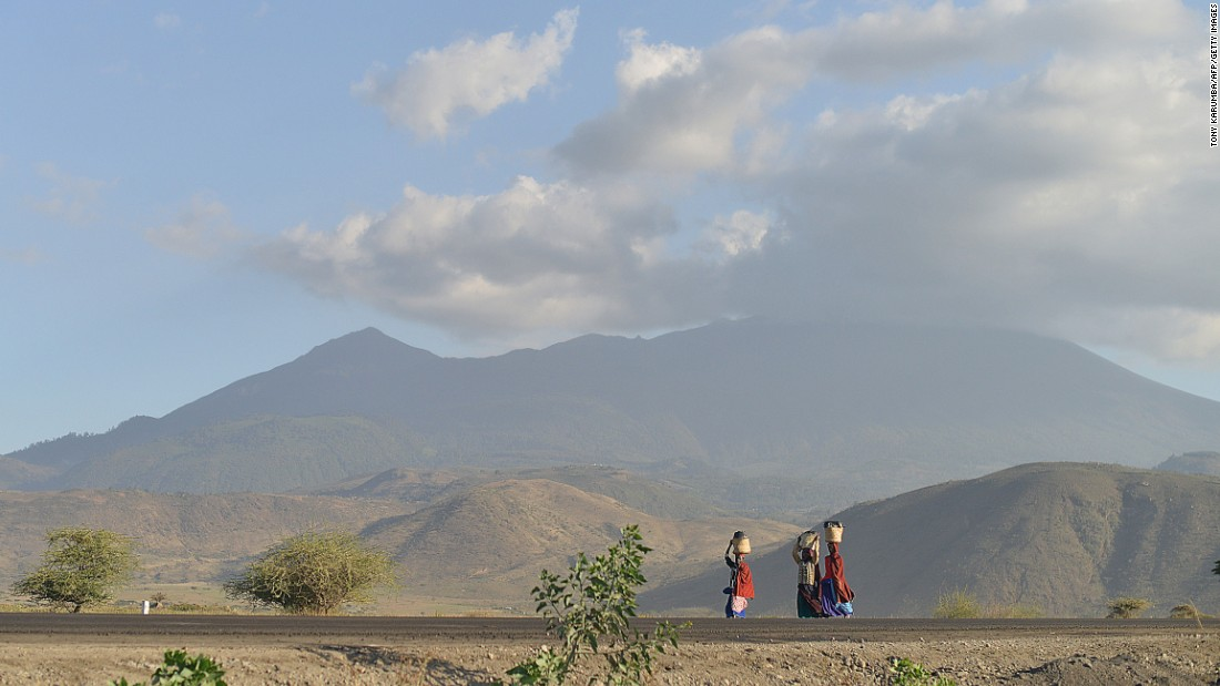 "Maasai women carry water near the border of Kenya and Tanzania. ""Women spend an average of four-and-a-half hours doing unpaid work every day, compared to an average of about two hours per day for men,"" say Bill and Melinda Gates."