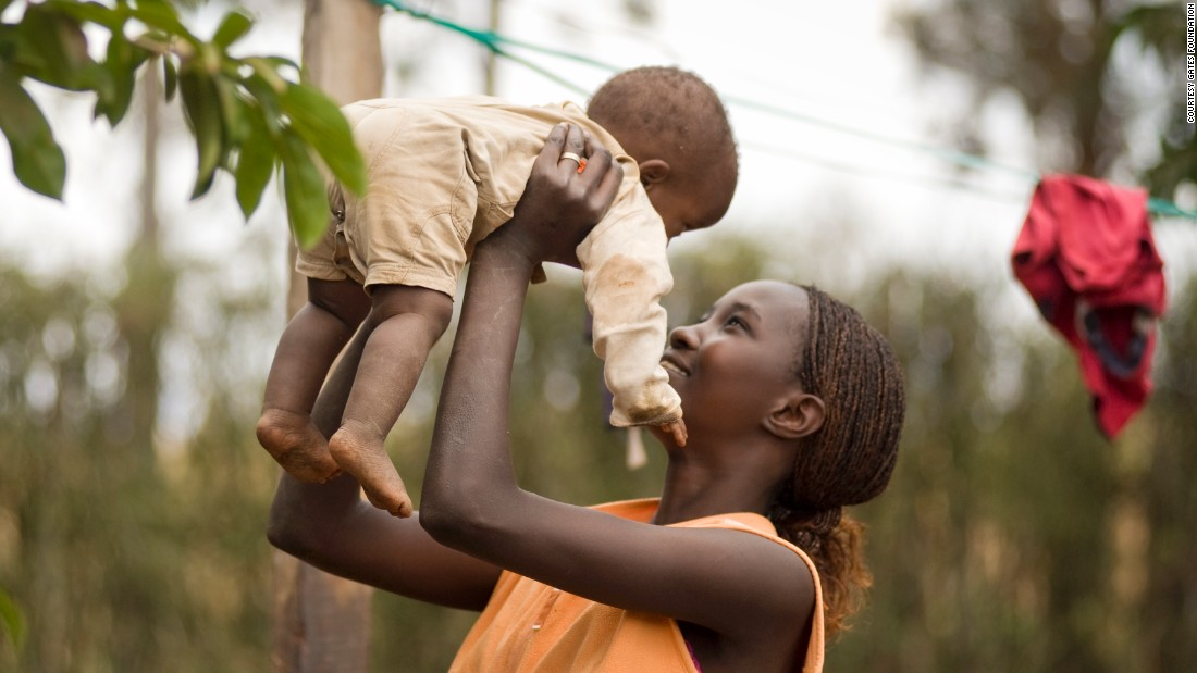 "A mother holds her child in Mwea Village, Kenya. ""Women are so busy meeting basic needs that they can't invest in the future by doing paid work, going to school, or visiting the doctor regularly,"" Bill and Melinda Gates say in a recent CNN op-ed."