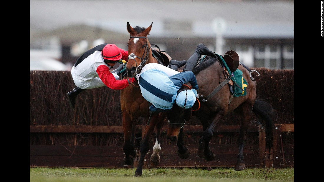 Victoria Pendleton, left, and Carey Williamson fall off their horses during a steeplechase race in Fakenham, England, on Friday, February 19. Pendleton is a former Olympic cyclist who won the keirin at the 2012 Games.