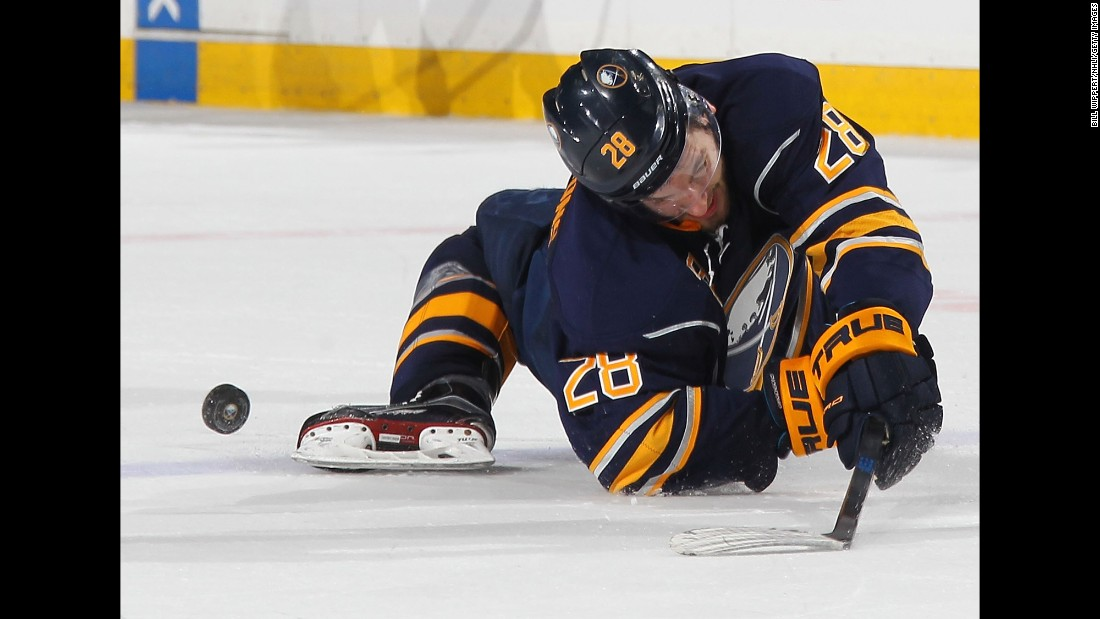 Zemgus Girgensons falls awkwardly after colliding with a Pittsburgh player in Buffalo, New York, on Saturday, February 21.