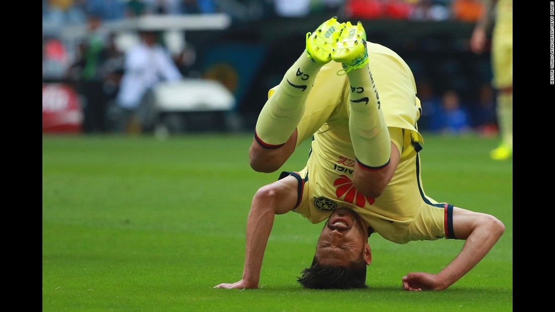 Club America's Oribe Peralta falls down Saturday, February 20, during a league match against Cruz Azul in Mexico City.