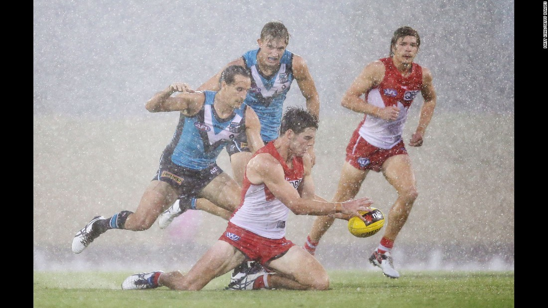 George Hewett of the Sydney Swans is tackled during an Australian Football League match against the Port Adelaide Power on Saturday, February 20.