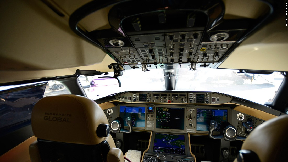 The Vision flight deck is one of the highlights on Global 6000. Its head-up display (the pink glass in the top left) projects important flight data for pilots. Its enhanced vision system replicates the terrain outside in conditions with little or no visibility.