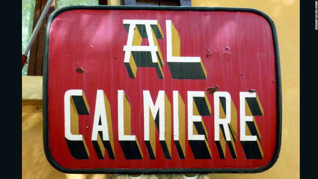 A tin plate sign for the Al Calmiere restaurant in Verona.