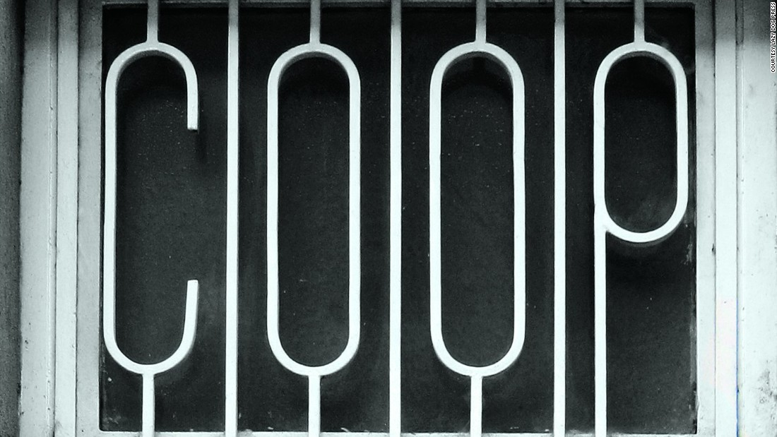 Iron bars with letters protecting a window on an office in Milan.