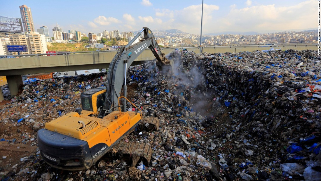 Workers arrange piles of garbage in the Hazimiye neighborhood of Beirut on February 3.