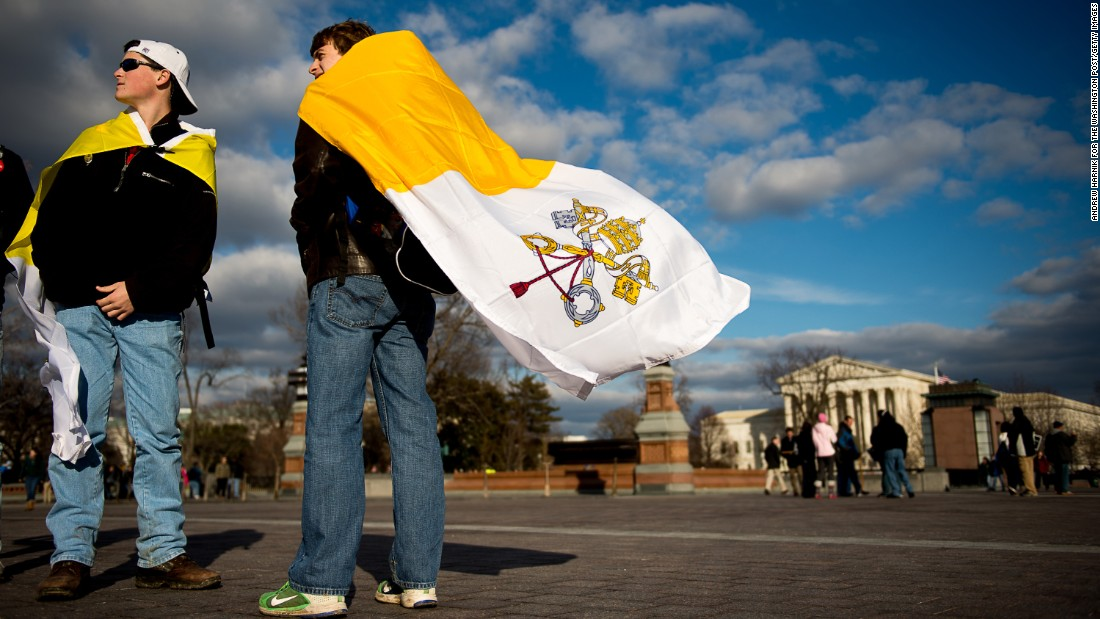 "On the 42nd anniversary of Roe v. Wade -- January 22, 2015 -- Evan Keimig of Houston, left, and Brandan Solcher of Sugarland, Texas, wear Vatican flags in front of the U.S. Capitol following a ""March for Life"" protest."