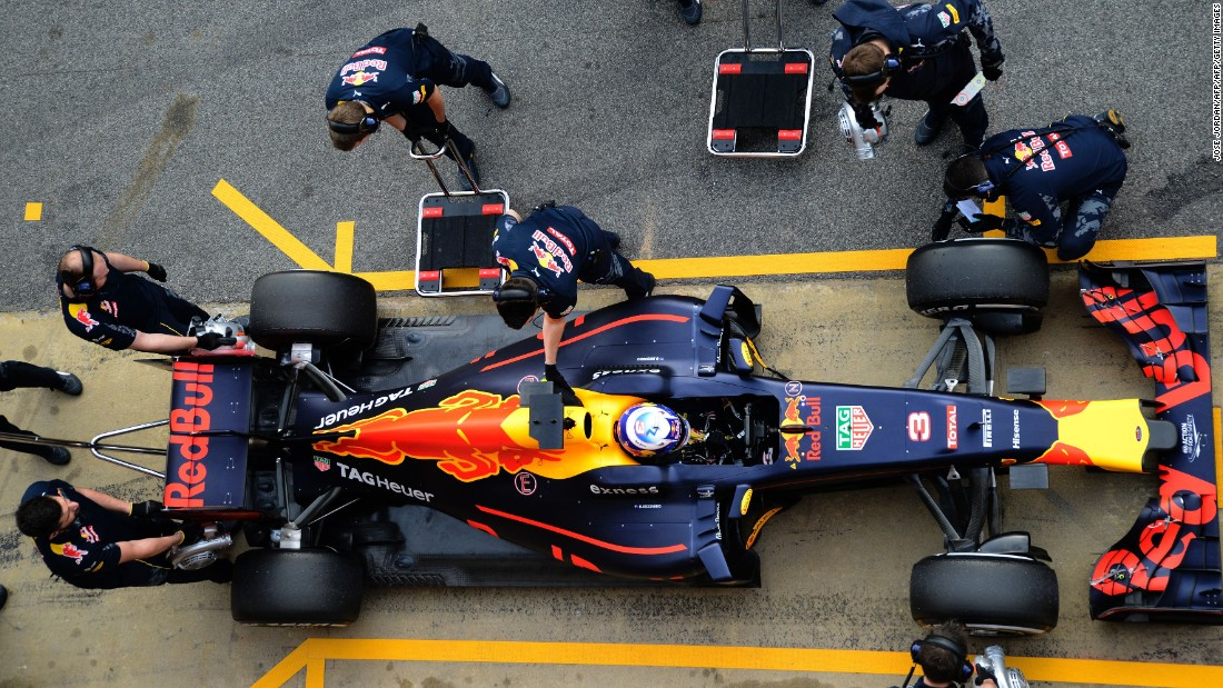 Looking good from above. The Red Bull Racing pit crew get set as Ricciardo brings his new racer back into the pits at the Circuit de Catalunya, the home of F1's winter testing.